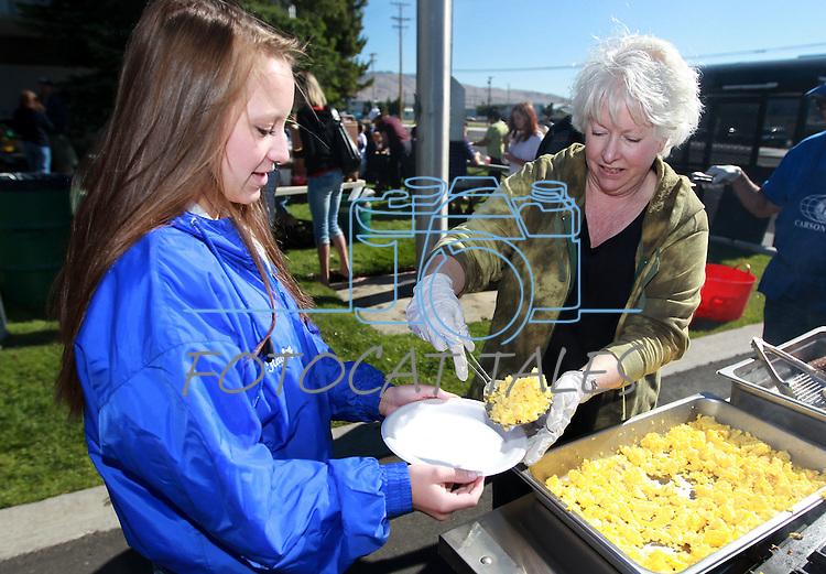 Rita Carman serves Hayley Canfield, 16, at the Carson City Library Summer Reading Program Pancake Breakfast Kick-Off, Saturday, June 9, 2012. .Photo by Cathleen Allison