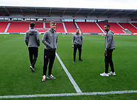 Lincoln City's Callum Connolly, left, Jack Payne, centre and Max Melbourne inspect the Doncaster Rovers pitch on arrival<br /> <br /> Photographer Andrew Vaughan/CameraSport<br /> <br /> EFL Leasing.com Trophy - Northern Section - Group H - Doncaster Rovers v Lincoln City - Tuesday 3rd September 2019 - Keepmoat Stadium - Doncaster<br />  <br /> World Copyright © 2018 CameraSport. All rights reserved. 43 Linden Ave. Countesthorpe. Leicester. England. LE8 5PG - Tel: +44 (0) 116 277 4147 - admin@camerasport.com - www.camerasport.com