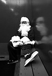 Santa Claus in skates takes a break in the arena dressing room.