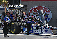 Apr. 7, 2013; Las Vegas, NV, USA: NHRA crew members push top fuel dragster driver Antron Brown into the water box during the Summitracing.com Nationals at the Strip at Las Vegas Motor Speedway. Mandatory Credit: Mark J. Rebilas-