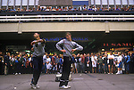 Break Dancing Stockport Lancashire. 1980s Britain. Crowds gather at shopping centre to watch two young men display their skills. Note the music comes from a so called Ghetto Blaster, a radio tape recorder player on floor half hidden. The shopping centre was in Mersey Square and the area was known as the Bear Pit.