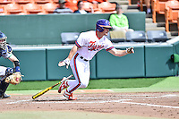 Clemson Tigers center fielder Tyler Slaton (18) swings at a pitch during a game against the Notre Dame Fighting Irish during game one of a double headers at Doug Kingsmore Stadium March 14, 2015 in Clemson, South Carolina. The Tigers defeated the Fighting Irish 6-1. (Tony Farlow/Four Seam Images)
