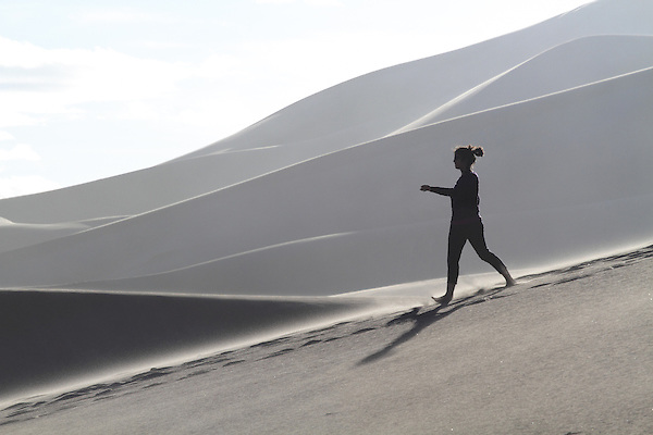 Woman descending in Great Sand Dunes National Park, Colorado John offers private photo trips to Great Sand Dunes National Park and all of Colorado. All year long.