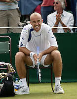 28-6-06,England, London, Wimbledon, first round match,  Ljubicic