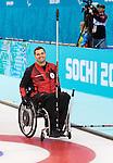 Mark Ideson, Sochi 2014 - Para Ice Hockey // Para-hockey sur glace.<br /> Canada's Wheelchair Curling Team practices before the games begin // L'équipe canadienne de curling en fauteuil roulant s'entraîne avant le début des Jeux. 07/03/2014.