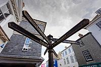 Destination arrowson the High Street in Totnes, England, UK. Wednesday 14 April 2021