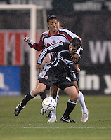 DC United midfielder Ben Olsen (14) shields the ball from CD Guadalajara forward Sergio Mendoza (21 in the first leg of the 2007 CONCACAF Champions' Cup Semifinal match between DC United and CD Chivas from Guadalajara, DC United tied Chivas 1-1 on March 15, 2007 at RFK Stadium in Washington DC.