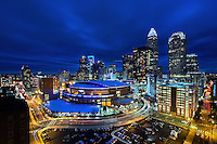 Charlotte Skyline Photography -  Exterior photo of the Spectrum Center against the uptown Charlotte skyline in Charlotte North Carolina. <br /> <br />  <br /> Charlotte Photographer - PatrickSchneiderPhoto.com