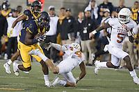 BERKELEY, CA - September 17, 2016: Cal's (15) Wide receiver Jordan Veasy slips pass Texas defender (14) Dylan Haines as (5) Holton Hill looks on at Cal Memorial Stadium.