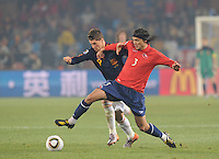 Spain's Fernando Torres and Chile's Waldo Ponce compete for possession of the ball. Spain won Group H following a 2-1 defeat of Chile in Pretoria's Loftus Versfeld Stadium, Friday, June 25th, at the 2010 FIFA World Cup in South Africa..
