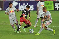 WASHINGTON, DC - SEPTEMBER 12: Junior Moreno #5 of D.C. United battles for the ball with Daniel Royer #77 and Kaku #10 of New York Red Bulls during a game between New York Red Bulls and D.C. United at Audi Field on September 12, 2020 in Washington, DC.