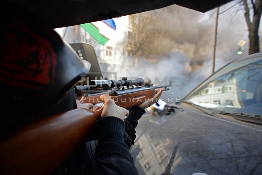 Protesters use  sniper rifles during the most violent moments of the protest in Maidan square. Kiev, Ukraine