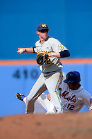 Michigan Wolverines infielder Jacob Croneworth #2 looks to first as Brandon Hicks #12 slides in during an exhibition game against the New York Mets at Tradition Field on February 24, 2013 in St. Lucie, Florida.  New York defeated Michigan 5-2.  (Mike Janes/Four Seam Images)