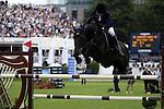August 07, 2009: Svante Johansson (SWE) clear the 4th fence aboard Saint Amour 1125. Meydan FEI Nations Cup. Failte Ireland Horse Show. The RDS, Dublin, Ireland.