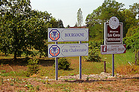 Road signs in Bourgogne: Cote Chalonnaise, Caves Particulieres, Melenotte Drillien