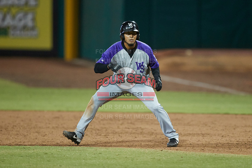 Lenyn Sosa (25) of the Winston-Salem Dash takes his lead off of first base against the Greensboro Grasshoppers at First National Bank Field on June 3, 2021 in Greensboro, North Carolina. (Brian Westerholt/Four Seam Images)
