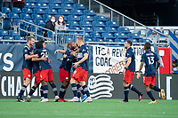 FOXBOROUGH, MA - MAY 1: New England players celebrate their goal during a game between Atlanta United FC and New England Revolution at Gillette Stadium on May 1, 2021 in Foxborough, Massachusetts.