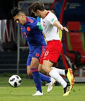 KAZAN - RUSIA, 24-06-2018: Grzegorz KRYCHOWIAK (Der) jugador de Polonia disputa el balón con Radamel FALCAO (Izq) jugador de Colombia durante partido de la primera fase, Grupo H, por la Copa Mundial de la FIFA Rusia 2018 jugado en el estadio Kazan Arena en Kazán, Rusia. /  Grzegorz KRYCHOWIAK (R) player of Polonia fights the ball with Radamel FALCAO (L) player of Colombia during match of the first phase, Group H, for the FIFA World Cup Russia 2018 played at Kazan Arena stadium in Kazan, Russia. Photo: VizzorImage / Julian Medina / Cont