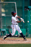 GCL Braves second baseman Braulio Vasquez (20) swings at a pitch during the first game of a doubleheader against the GCL Yankees West on July 30, 2018 at Champion Stadium in Kissimmee, Florida.  GCL Yankees West defeated GCL Braves 7-5.  (Mike Janes/Four Seam Images)