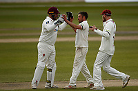 15th April 2021; Emirates Old Trafford, Manchester, Lancashire, England; English County Cricket, Lancashire versus Northants; Former Lancashire spinner Simon Kerrigan celebrates with Rob Keogh and keeper Adam Rossington after he takes the wicket of Dane Villas lbw for26