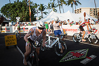 Tyler Butterfield, Marko Albert,  Timo Bracht, and Faris Al-Sultan all exit T1 at the same time at the 2013 Ironman World Championship in Kailua-Kona, Hawaii on October 12, 2013.