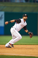 Arkansas Travelers third baseman Brian Hernandez (12) fields a ground ball during a game against the Corpus Christi Hooks on May 29, 2015 at Dickey-Stephens Park in Little Rock, Arkansas.  Corpus Christi defeated Arkansas 4-0 in a rain shortened game.  (Mike Janes/Four Seam Images)