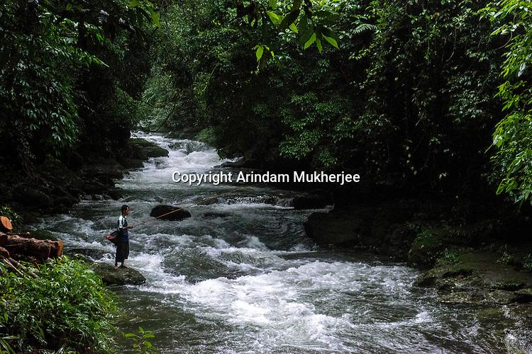 Khasi man fishing in a rivulet in Mawlynnong village in East Khasi Hills - the wettest place on Earth. Arindam Mukherjee