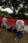 Pinellas Park, Florida.USA.March 25, 2005..Protesters on Good Friday pray outside the Woodside Hospice in Pinellas Park, Florida where Terri Schiavo is bedded. As Terri Schiavo's health waned, a federal judge refused Friday to order the reinsertion of her feeding tube, thwarting another legal move from the brain-damaged woman's parents. Schiavo's feeding tube was removed by court order on March 18, 2005.