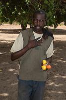 Farmer with Cashew Nuts and cashew Apples, near Sokone, Senegal