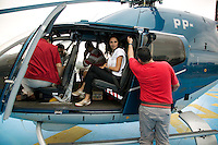 The general manager of an international hotel chain invites his friends to fly to the golf club in central Sao Paulo. They are taking off from the helipad at the top of Daslu, the most up-market clothes shop in the city.