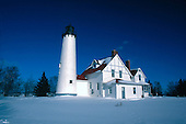 Iroquois Pt Lighthouse in Michigan's Upper Peninsula, on Lake Superior near Bay Mills, Michigan in winter.