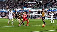 Laurent Koscielny of Arsenal scores a goal to make the score 0-2 during the Barclays Premier League match between Swansea City and Arsenal played at The Liberty Stadium, Swansea on October 31st 2015