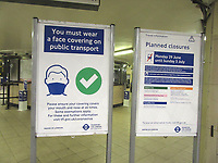 Sign at entrance to the Tube, warning that wearing Face covering on the London Underground is now compulsory<br /> Social Distancing, Hand Sanitiser stations and NHS signage around London as Lockdown restrictions are loosened by allowing Pubs, Restaurants and all retail to re-open. London on Saturday July 4th 2020<br /> <br /> Photo by Keith Mayhew
