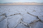 The salt flats of Badwater with the mountains in the background in Death Valley National Park, Nevada, United States of America.