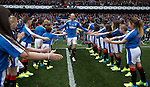 Kenny Miller leads out the teams