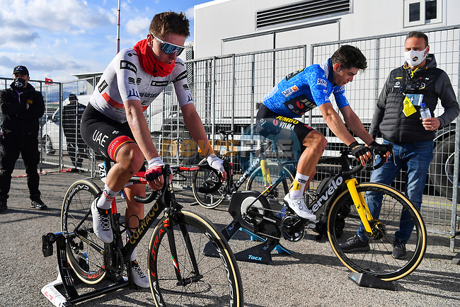 Stage winner and new race leader Tadej Pogacar (SLO) UAE Team Emirates and previous race leader Wout Van Aert (BEL) Team Jumbo-Visma warm down after Stage 4 of Tirreno-Adriatico Eolo 2021, running 148km from Terni to Prati di Tivo, Italy. 13th March 2021. <br /> Photo: LaPresse/Marco Alpozzi | Cyclefile<br /> <br /> All photos usage must carry mandatory copyright credit (© Cyclefile | LaPresse/Marco Alpozzi)