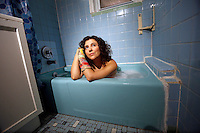"""NEW YORK - SUNDAY NEWS:  Brooklyn artist Siobhan O'Loughlin inside of her most recent performance space, Astoria, Queens, NY, Friday, January 27, 2017.  Using a stranger's bathtub as her performance space, O'Loughlin performs an interactive show naked called, """"Broken Bone Bathtub,"""" .<br /> <br /> PICTURED:  <br /> <br /> (Angel Chevrestt, 646.314.3206)"""