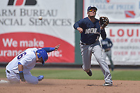 Miguel Rojas (11) of the New Orleans Zephyrs throws to first base to complete a double play against the Iowa Cubs at Principal Park on April 23, 2015 in Des Moines, Iowa.  The Zephyrs won 9-2.  (Dennis Hubbard/Four Seam Images)