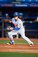St. Lucie Mets shortstop Andres Gimenez (12) runs to first base after laying down a bunt during the first game of a doubleheader against the Charlotte Stone Crabs on April 24, 2018 at First Data Field in Port St. Lucie, Florida.  St. Lucie defeated Charlotte 5-3.  (Mike Janes/Four Seam Images)
