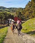 Arron and son Ethan riding horseback in San Luis Obispo, California