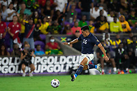 ORLANDO, FL - JULY 20: Adrian Martinez #16 of Costa Rica kicks the ball during a game between Costa Rica and Jamaica at Exploria Stadium on July 20, 2021 in Orlando, Florida.