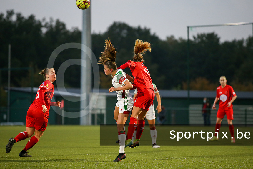 (Left to right) Jill Janssens of OHL (7) and Estelle Peron of Woluwe (45) battle for the ball  during a female soccer game between Oud Heverlee Leuven and Femina White Star Woluwe  on the 5 th matchday of the 2020 - 2021 season of Belgian Womens Super League , Sunday 18 th of October 2020  in Heverlee , Belgium . PHOTO SPORTPIX.BE | SPP | SEVIL OKTEM