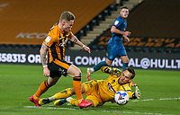 Grimsby Town's James McKeown saves at the feet of Hull City's Thomas Mayer<br /> <br /> Photographer Alex Dodd/CameraSport<br /> <br /> EFL Papa John's Trophy - Northern Section - Group H - Hull City v Grimsby Town - Tuesday 17th November 2020 - KCOM Stadium - Kingston upon Hull<br />  <br /> World Copyright © 2020 CameraSport. All rights reserved. 43 Linden Ave. Countesthorpe. Leicester. England. LE8 5PG - Tel: +44 (0) 116 277 4147 - admin@camerasport.com - www.camerasport.com