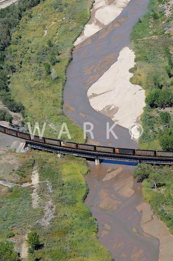 Train coal cars crossing Fountain River