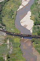 Train coal cars crossing Fountain River