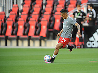WASHINGTON, DC - MAY 13: Andy Najar #14 of D.C. United warming up before a game between Chicago Fire FC and D.C. United at Audi FIeld on May 13, 2021 in Washington, DC.