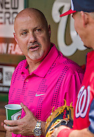 20 May 2014: Washington Nationals General Manager Mike Rizzo chats in the dugout prior to a game against the Cincinnati Reds at Nationals Park in Washington, DC. The Nationals defeated the Reds 9-4 to take the second game of their 3-game series. Mandatory Credit: Ed Wolfstein Photo *** RAW (NEF) Image File Available ***