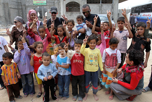 Italian peace activists who have a friendship with Vittorio Arrigoni play with children from al-Samoni family during their visit to Gaza Strip, in Gaza city on May 13,2011. Photo by Mohammed Asad