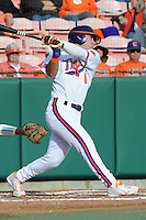 Center Fielder Thomas Brittle #4 of the Clemson Tigers swings at a pitch during  a game against the North Carolina Tar Heels at Doug Kingsmore Stadium on March 9, 2012 in Clemson, South Carolina. The Tar Heels defeated the Tigers 4-3. Tony Farlow/Four Seam Images.