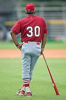 Johnson City Manager Joe Almaraz (30) watches as the Burlington Royals finish up their batting practice at Burlington Athletic Park in Burlington, NC, Sunday, July 15, 2007.